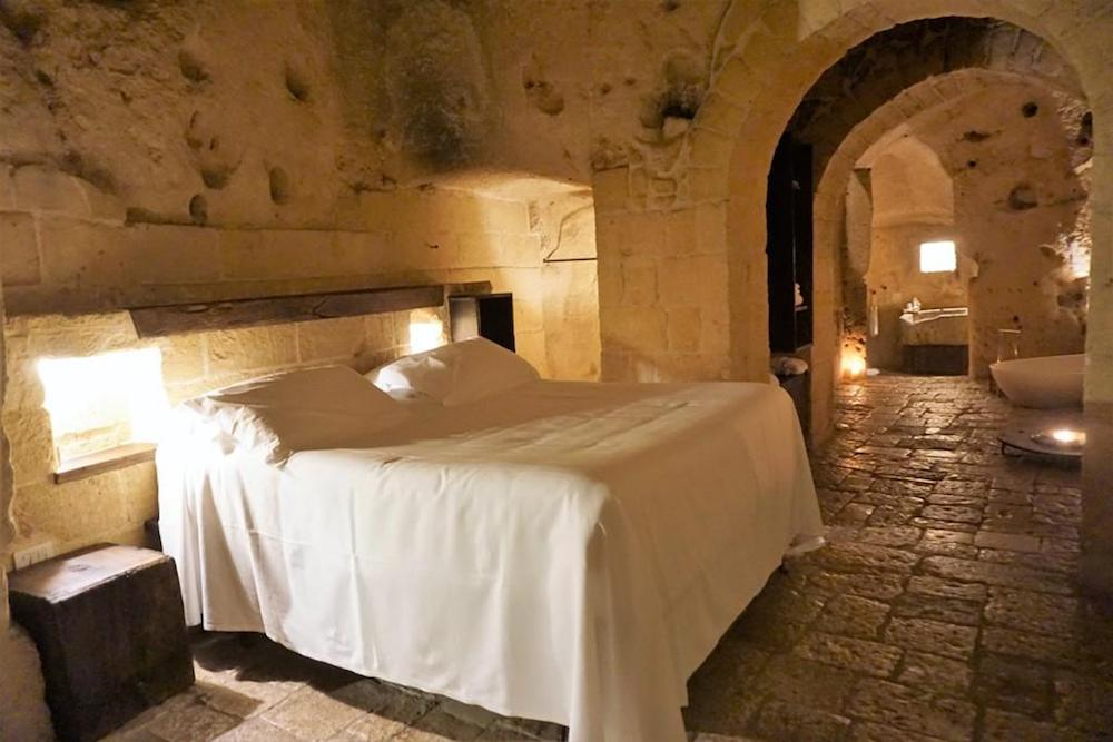 Sextantio Le Grotte della Civita is a luxurious cave hotel located in the Sassi area of Matera in Southern Italy. Its 18 guestrooms have stone made floors and walls, wooden traditional furniture and handcrafted bowls and jugs. The bathrooms are equipped with natural cosmetics and bamboo toothbrushes.