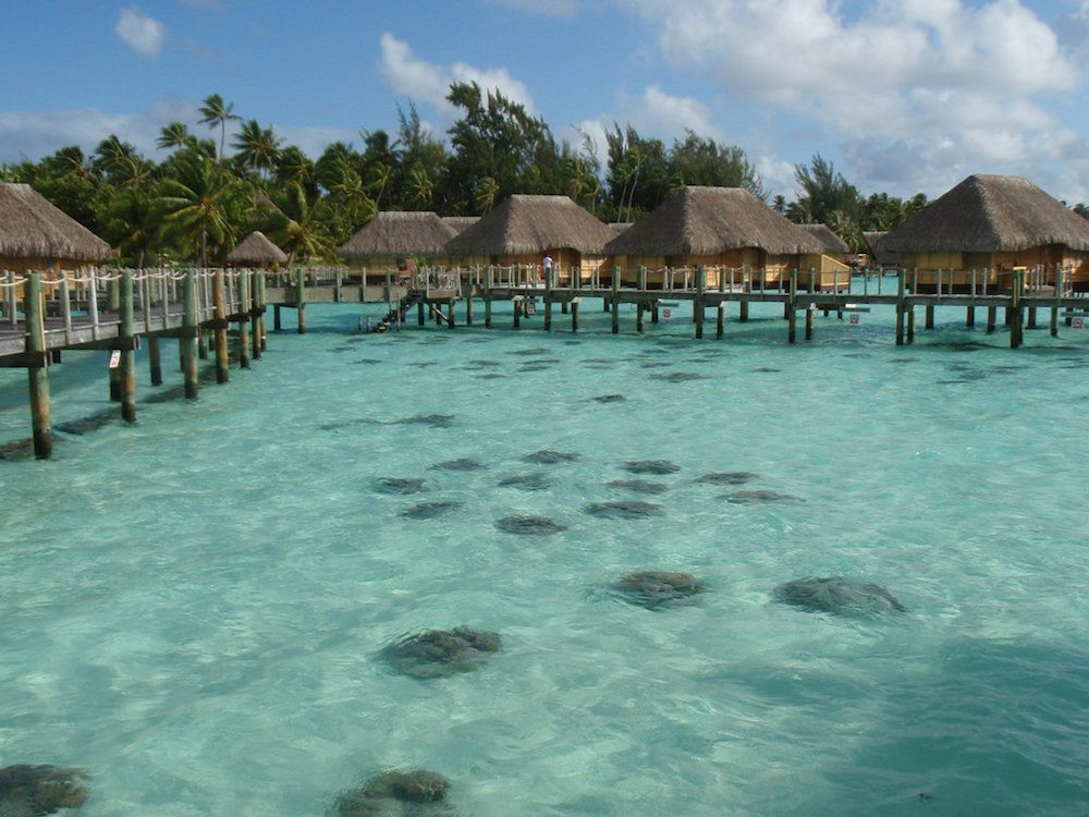 The most romantic hotel that we've ever stayed at is the Bora Bora Pearl Beach Resort, which is built on a motu just off the coast of Bora Bora, French Polynesia. This is where we honeymooned, and it has an absolutely idyllic setting.
