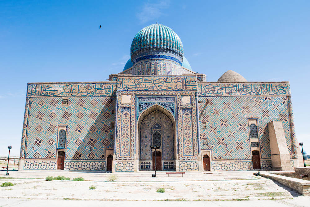 Mausoleum of Khoja Ahmed Yasawi in its full glory. Located in the town of Yasi, now Turkestan, was built at the time of Timur. This Mauseleum is unfinished on the front, but this is the back of this gorgeous Mauseleum.