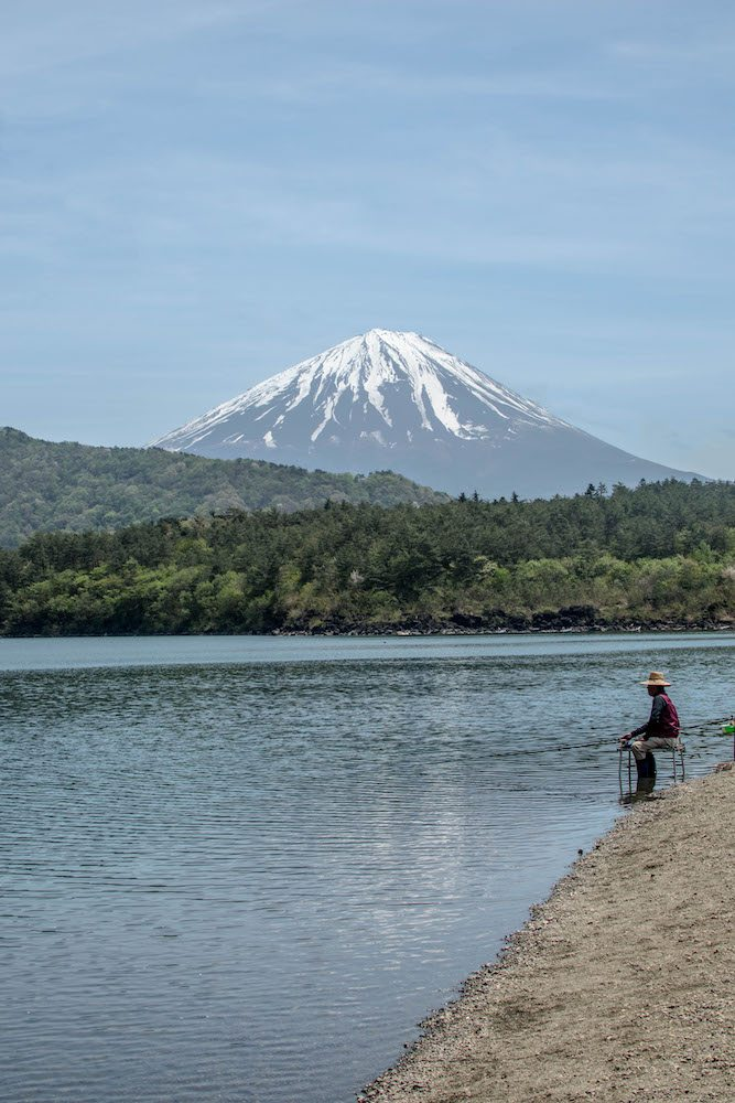 When we were walking around Lake Saiko, we saw this man fishing near the bus station. Such a beautiful sight. Thinking of climbing Mount Fuji? We didn't try it, but we did do some research for you!