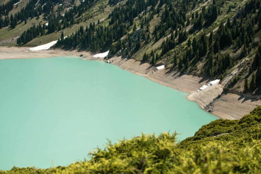 A photo of Big Almaty Lake, only 30 minutes away from Almaty. Big Almaty Lake sits 2500 meter above sea level in the Big Almaty Gorge. The lake tends to change colour depending on the weather and the time of the year. It varies from emerald green to a deep turquoise colour.